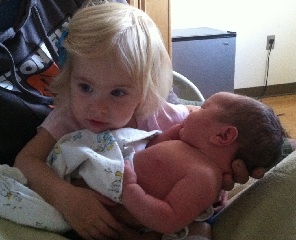 Madeline welcomes her baby brother Nathan, born 6/22.