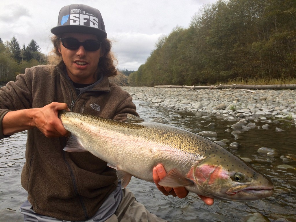 A dry line and a bead head got this summer steelhead cartwheeling for Chance.
