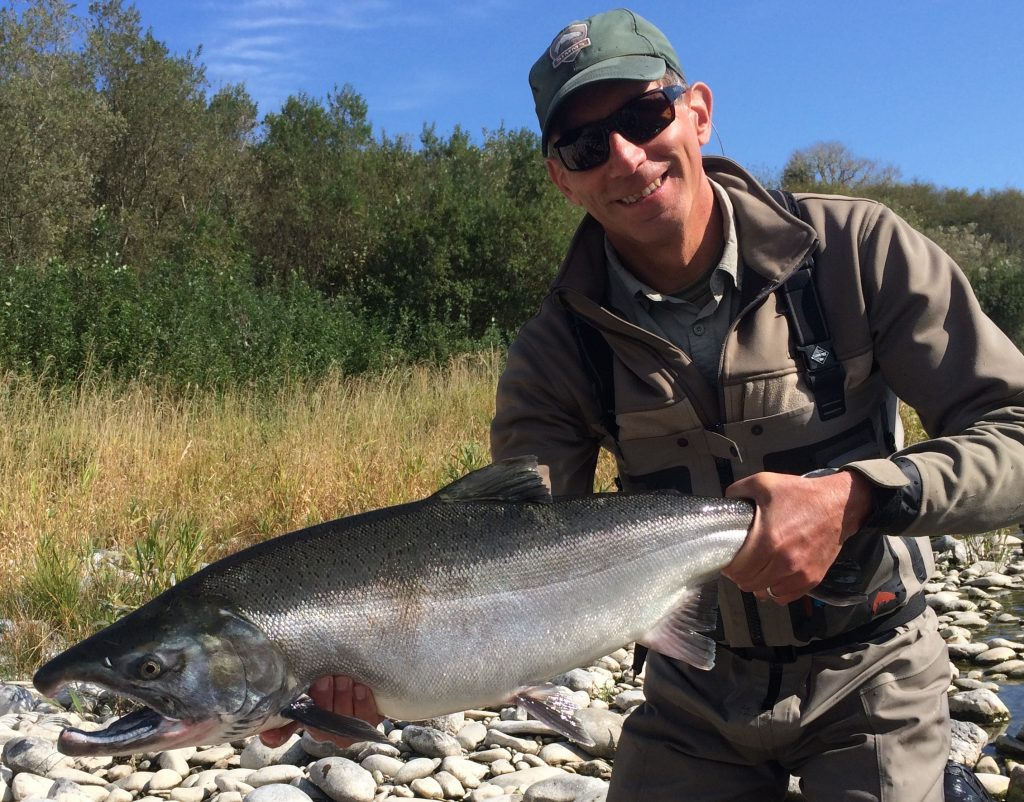 sight casting at chrome coho just above tide water got tim this big hatchery buck